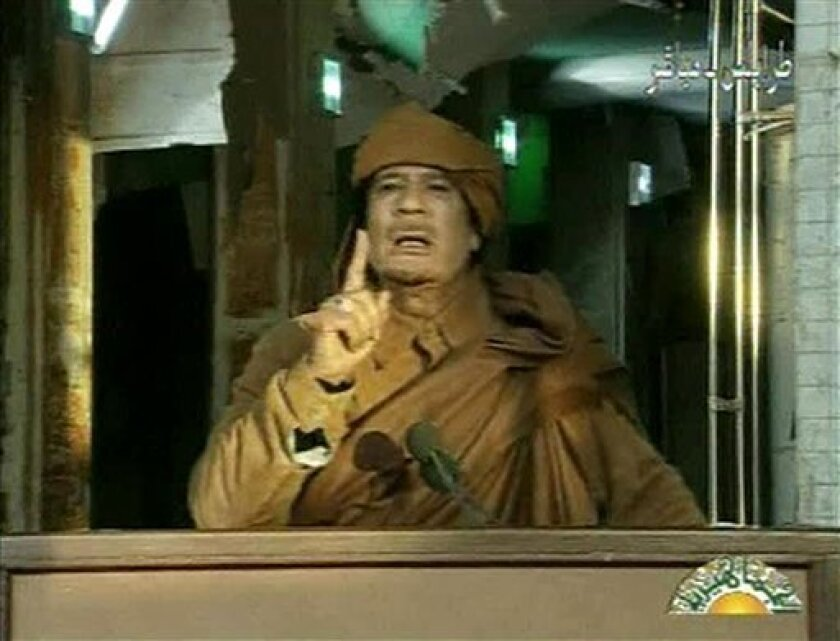 This image broadcast on Libyan state television on Feb. 22, 2011, shows Libyan leader Moammar Gadhafi as he addresses the nation in Tripoli, Libya. Gadhafi was ousted from power and assassinated later that year.