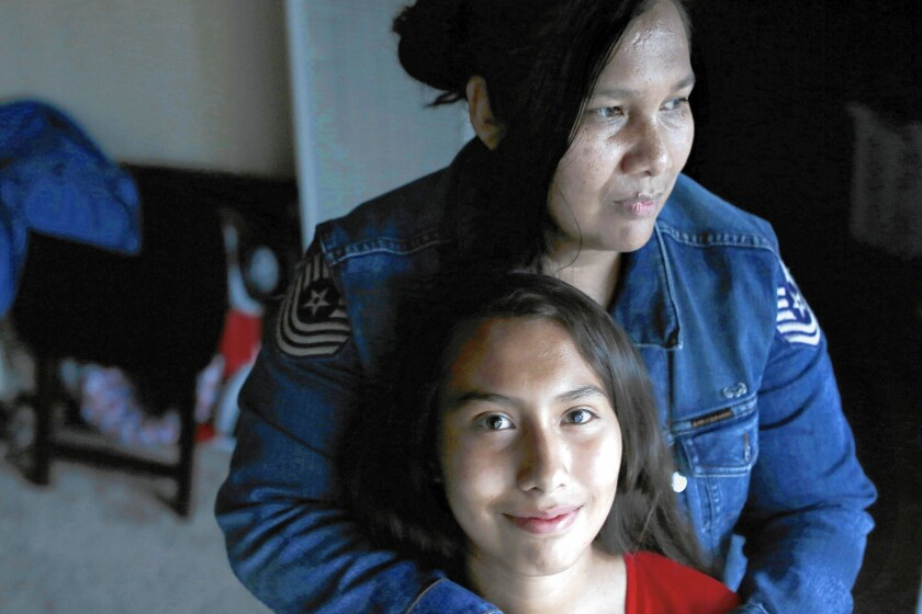 Lizeth Gallegos, 14, with her mother, Carolina Moran, in their Canoga Park apartment. Lizeth will be getting Medi-Cal health coverage.