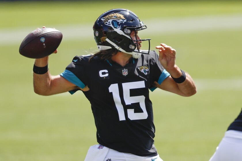 Jacksonville Jaguars quarterback Gardner Minshew (15) passes against the Tennessee Titans in the first half of an NFL football game Sunday, Sept. 20, 2020, in Nashville, Tenn. (AP Photo/Wade Payne)