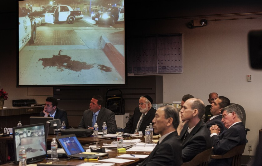Lawyers view image of a pool of blood left after Fullerton police arrested Kelly Thomas in 2011.