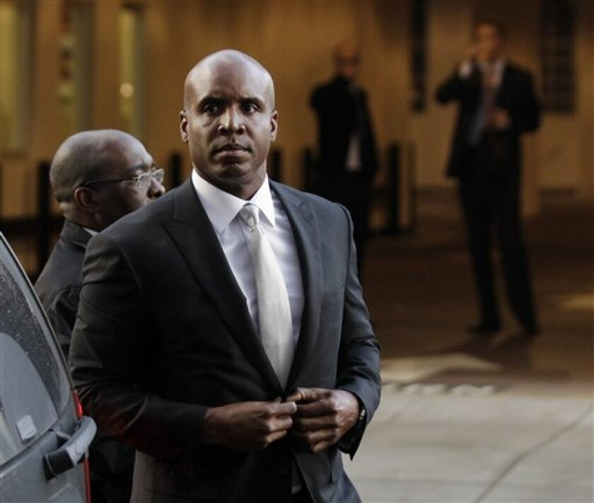 Barry Bonds arrives at the federal courthouse in San Francisco, Monday, March 21, 2011. The Bonds perjury trial is finally scheduled to get under way, more than three years after baseball's all-time home run leader was charged with lying to a federal grand jury when he denied knowingly taking performance-enhancing drugs. (AP Photo/Marcio Jose Sanchez)