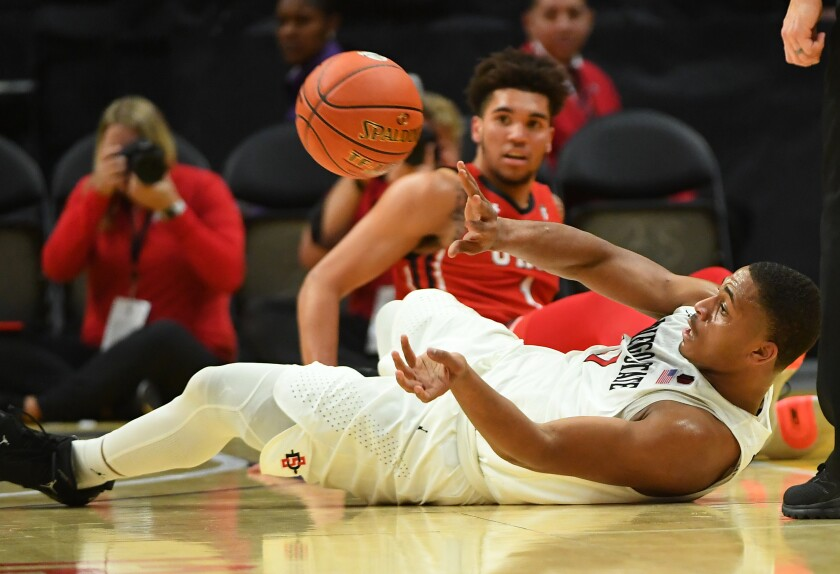 The Aztecs, fueled by plays like Matt Mitchell's dive for a loose ball, moved to 12-0 by knocking off Utah on Saturday at Staples Center in Los Angeles.