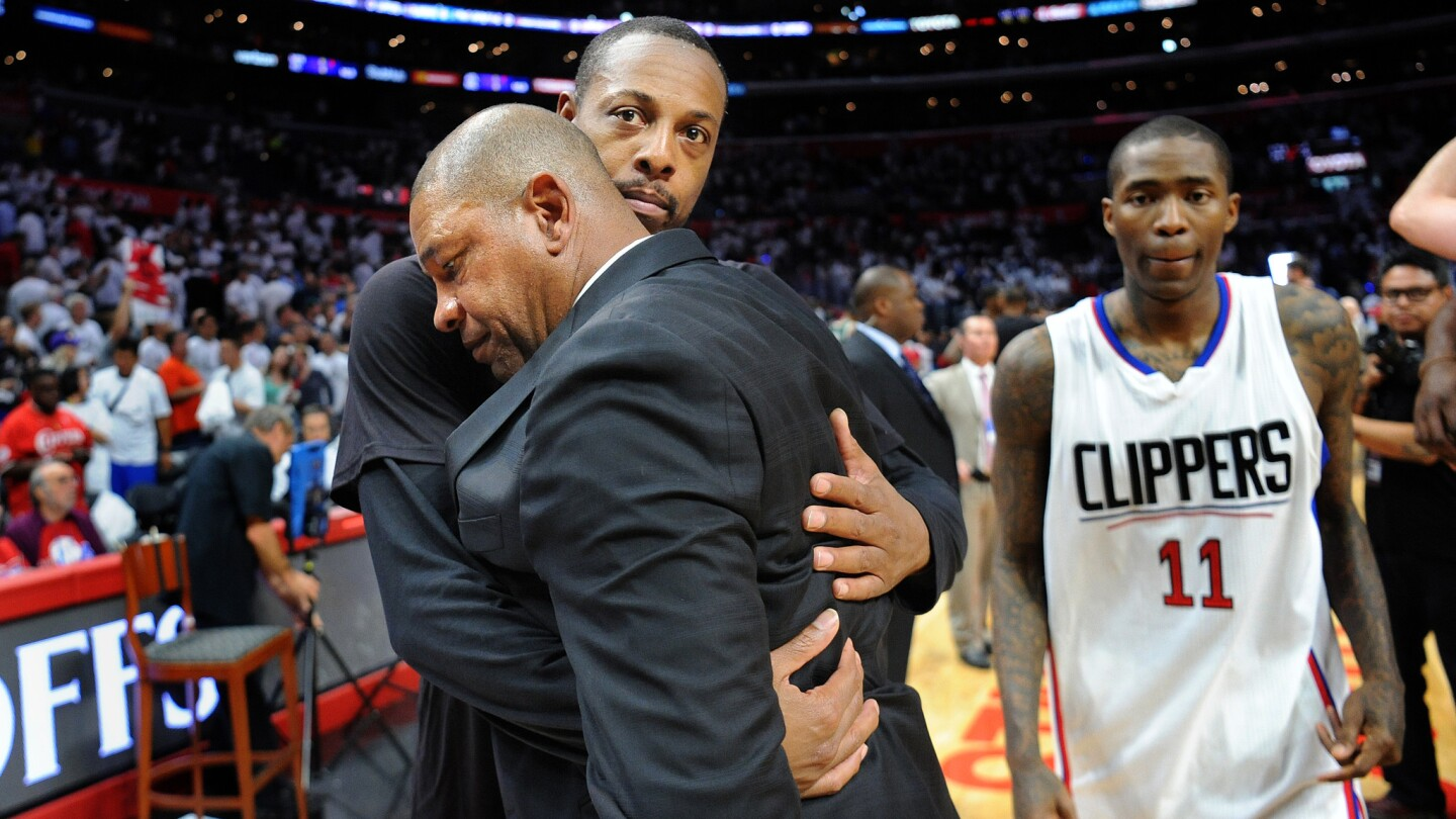 Clippers forward Paul Pierce hugs head coach Doc Rivers as Jamal Crawford (11) walks off the court after losing to the Jazz in Game 7.