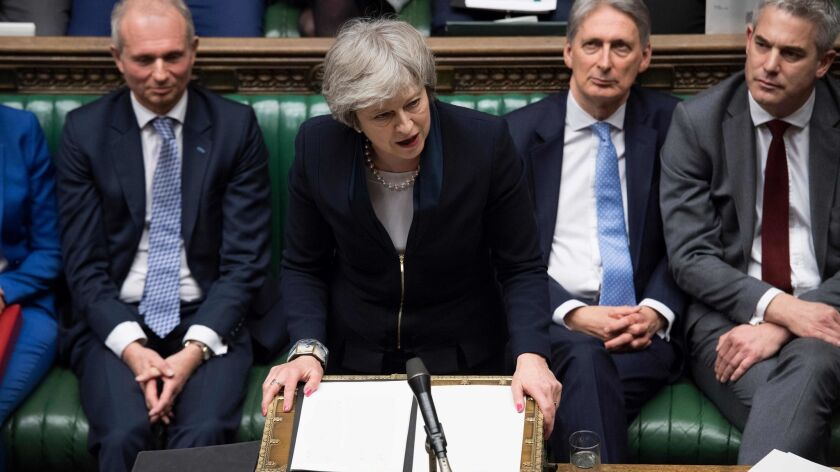 British Prime Minister Theresa May speaks in the House of Commons in London on Jan. 15.