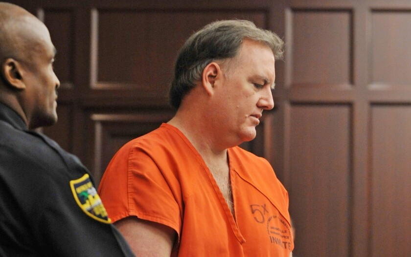 Michael Dunn, right, is directed to his seat in the Jacksonville, Fla., courtroom Sept. 11.