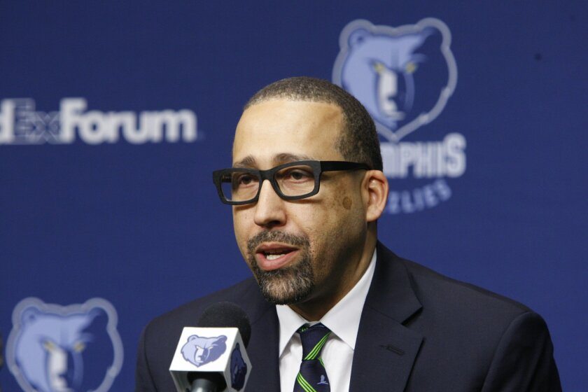 David Fizdale speaks at a news conference where he is introduced as the new head coach of the Memphis Grizzlies NBA basketball team Tuesday, May 31, 2016, in Memphis, Tenn. Fizdale was previously the assistant head coach of the Miami Heat. (AP Photo/Karen Pulfer Focht)