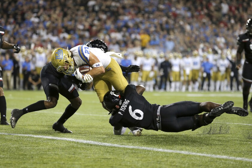 UCLA wide receiver Chase Cota scores a touchdown against Cincinnati during the second half of the Bruins' loss Thursday.