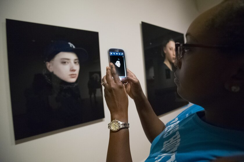 Guest visiting the Museum of Photographic Arts in Balboa Park are encouraged to take photographs of the exhibits and to share their photos through social media.