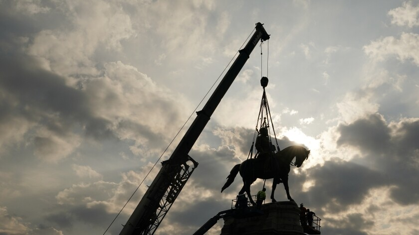 Crews work to remove one of the country's largest remaining monuments to the Confederacy, a towering statue of Confederate Gen. Robert E. Lee on Monument Avenue, Wednesday, Sept. 8, 2021, in Richmond, Va. (AP Photo/Steve Helber, Pool)