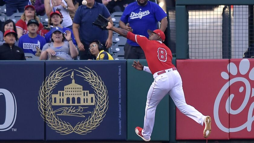 Angels left fielder Justin Upton can't catch up to a Max Muncy RBI double during the first inning. Upton was injured running into the wall.