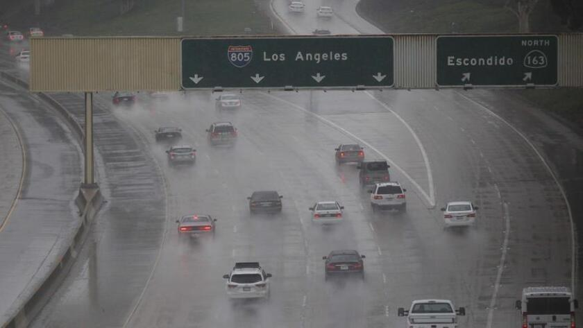 SAN DIEGO, CA-Jan 05, 2016: The morning commute was pretty tame, with the steady rain not hitting until about 9am. This is Highway 805. JOHN GIBBINS / San Diego Union-Tribune (/ John Gibbins / San Diego Union-Tribune)