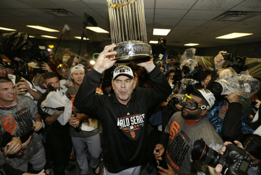 San Francisco Giants manager Bruce Bochy celebrates after Game 7 of baseball's World Series against the Kansas City Royals, Wednesday, Oct. 29, 2014, in Kansas City, Mo. The Giants won 3-2 to win the series. (AP Photo/David J. Phillip)