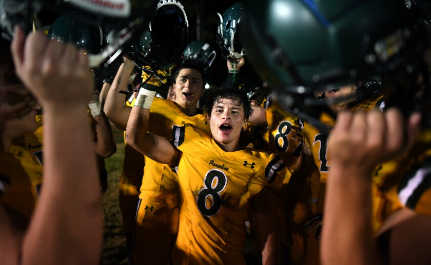 Paradise High School running back Brenden Moon celebrates with teammates