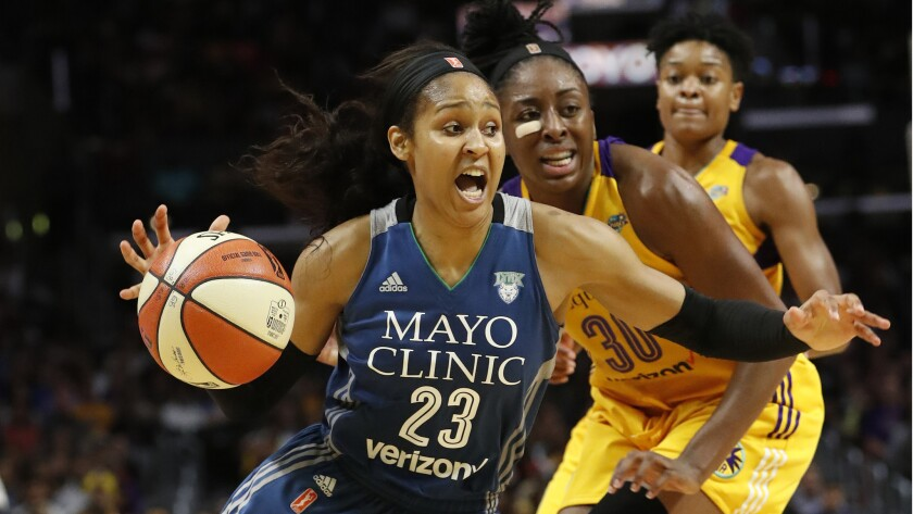 Lynx forward Maya Moore drives to the basket against Sparks forward Nneka Ogwumike during the fourth quarter.