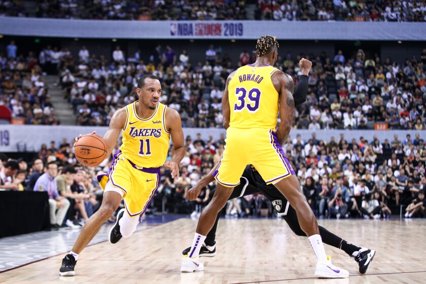 Lakers guard Avery Bradley drives around a screen set by center Dwight Howard during a preseason game in October.