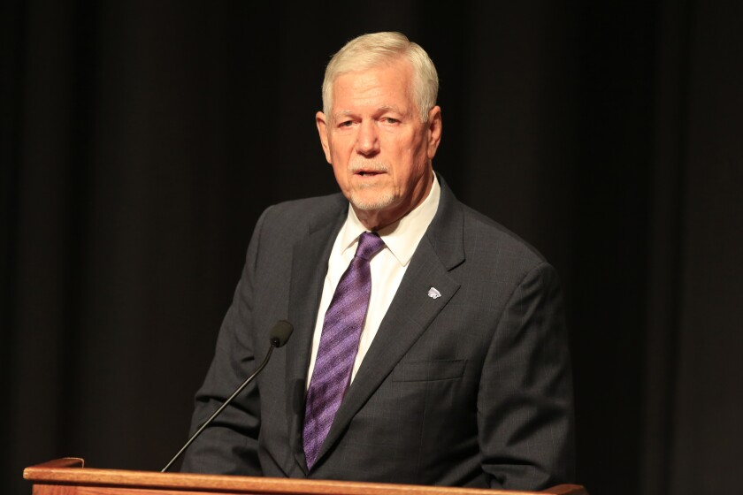 Kansas State President Richard Myers speaks during a news conference.