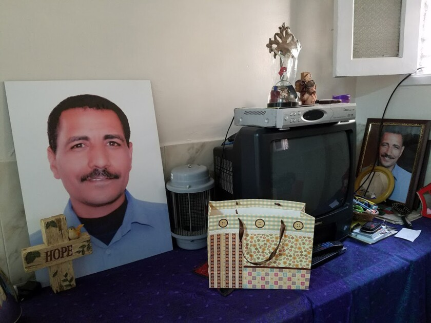 Portraits are set up in the home of Nabil Habib, 48, a church guard killed in an attack during Mass Dec. 11 at St. Mark's Cathedral in Cairo.