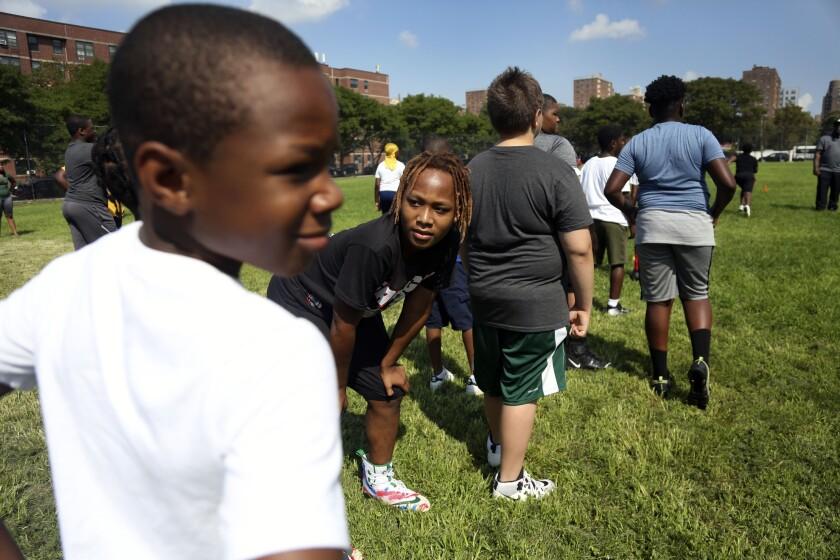 Mason Washington at his teammates at football practice