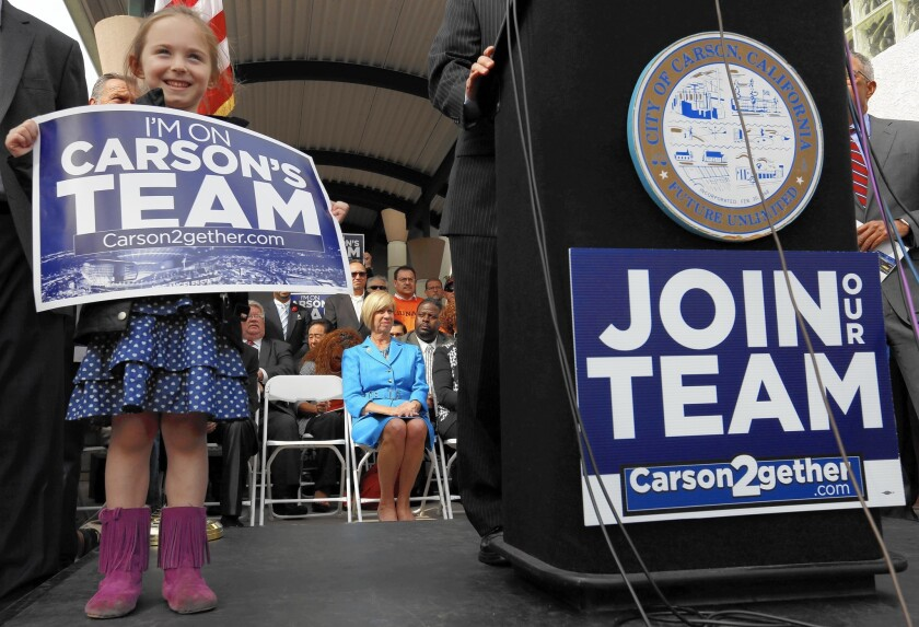 Rose Lehane, 6, and others wait for Rep. Janice Hahn (D-Los Angeles) to speak at a news conference at the proposed stadium site in Carson.