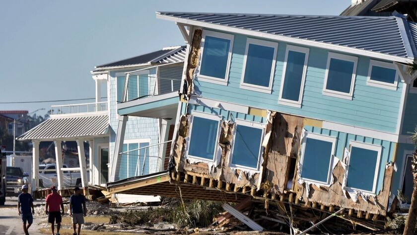 A building was knocked askew by Hurricane Michael in Mexico Beach, Fla. As of Sunday there was just one confirmed death in the town resulting from the storm.