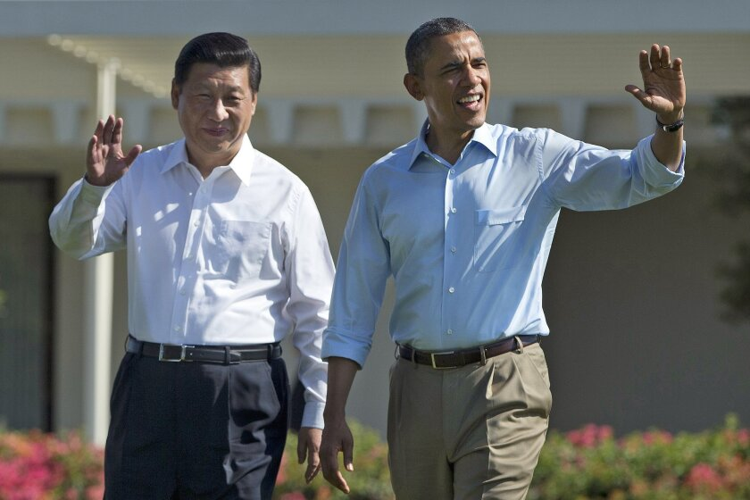 Chinese President Xi Jinping and President Obama walk together at the Annenberg Retreat of the Sunnylands estate in Rancho Mirage, Calif. on June 8, 2013.