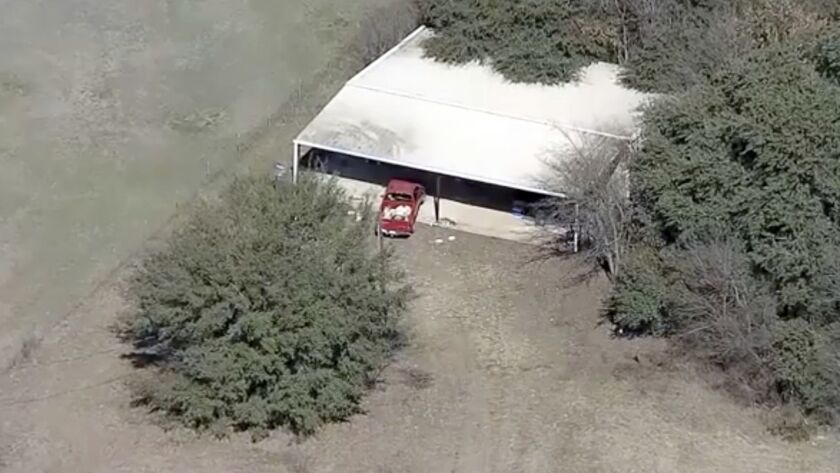 This aerial image provided by KDFW-FOX4 News shows part of the property where deputies found two you