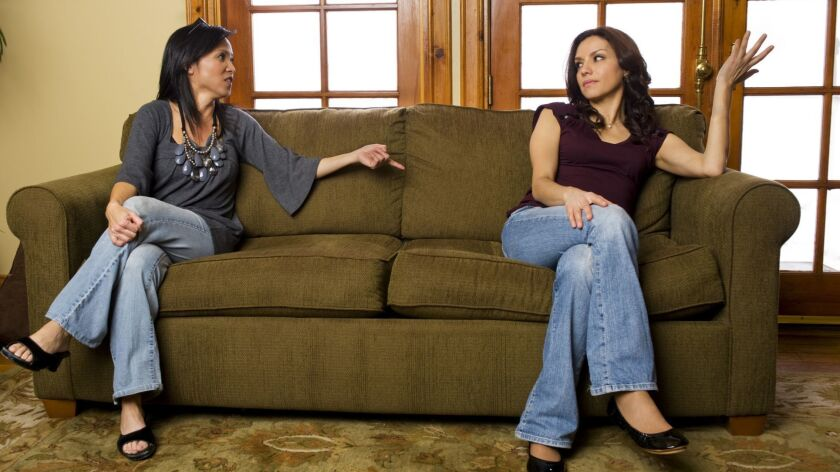 Two hispanic women arguing