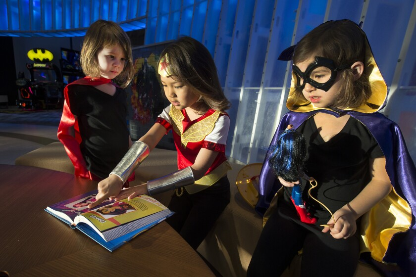 Among DC Super Hero Girls costumes are Batgirl, worn by Charlotte Osterloh, 6; Supergirl , worn by Elyse Osterloh, 4; and Wonder Woman, worn by Summer Taira, 7.