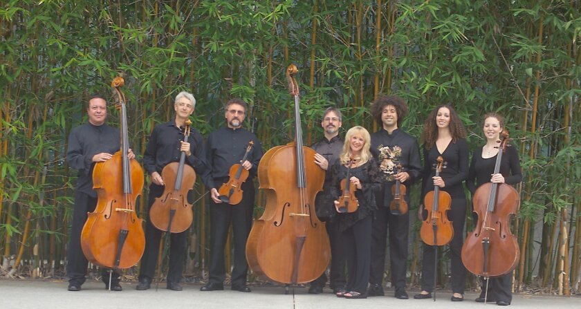 The Hutchins Consort will mix traditional baroque music with real-time computer animation and a world premiere at their Nov. 19 concert. Artistic director Joe McNalley is in the center of the photo, with his 'giant.' Courtesy