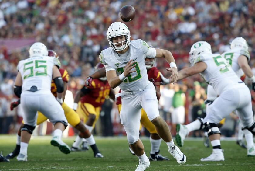Oregon quarterback Justin Herbert runs against USC.