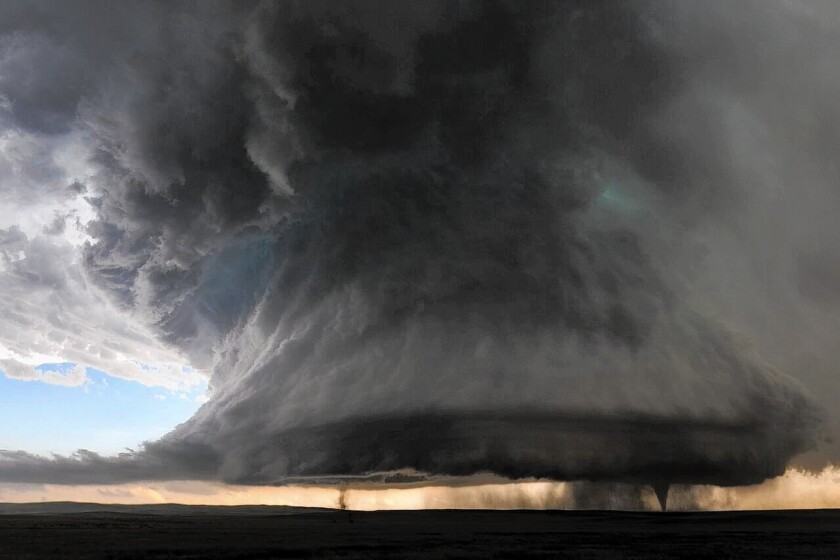 Twin tornadoes below a massive supercell formation near Simla, Colo., on June 4.