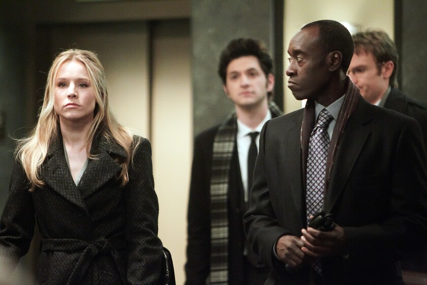 "Kristen Bell with Don Cheadle in Showtime's ""House of Lies."""
