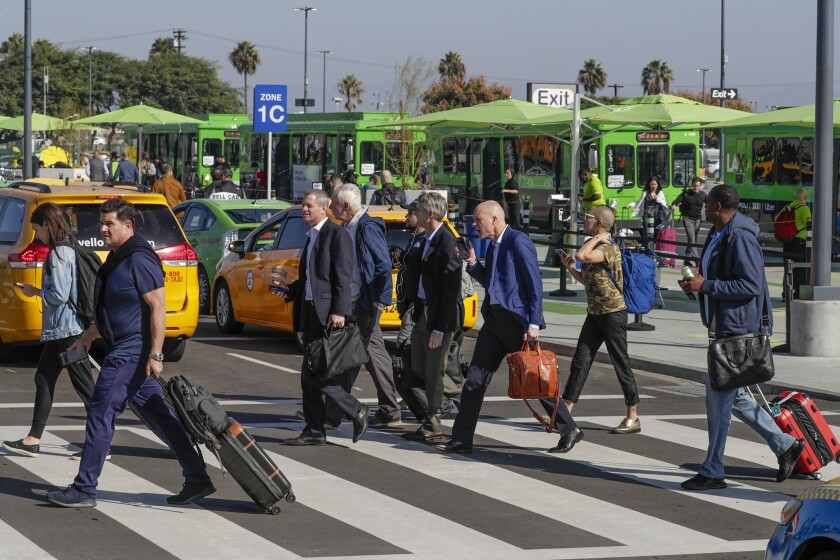 The death of the taxi industry? Passengers at the LAXit pickup lot at LAX try to contact their Uber or Lyft rides or find a taxi in early November, shortly after the arrangement began.