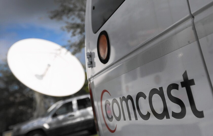 Netflix to pay Comcast for smoother online video streaming