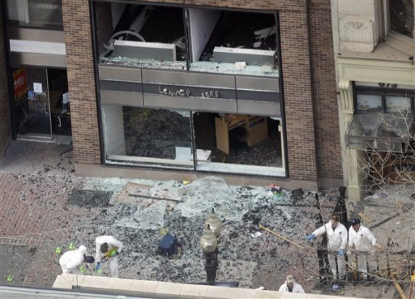 FBI examines shrapnel from Boston bombs as nation mourns