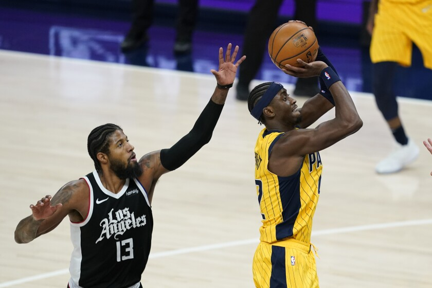 Indiana Pacers' Caris LeVert shoots against Clippers' Paul George.