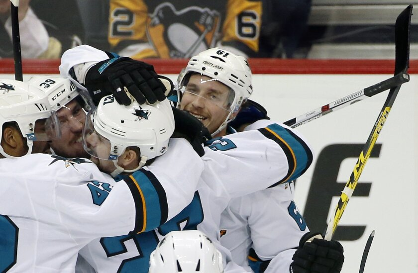 San Jose Sharks' Justin Braun, right, celebrates his goal against the Pittsburgh Penguins with teammates during the third period in Game 2 of the NHL hockey Stanley Cup Finals on Wednesday, June 1, 2016, in Pittsburgh. (AP Photo/Gene J. Puskar)