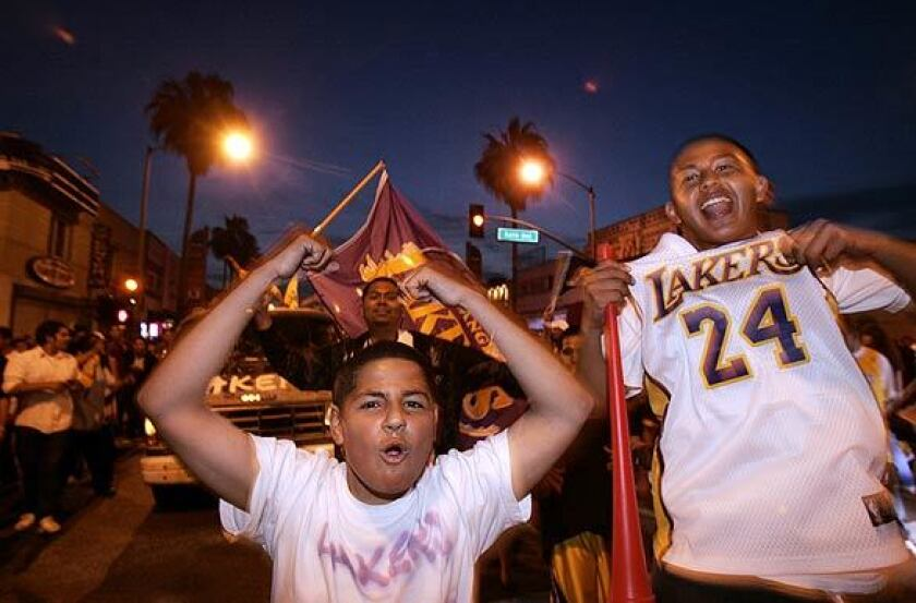 Lakers fans cruise up and down Whittier Boulevard in East Los Angeles