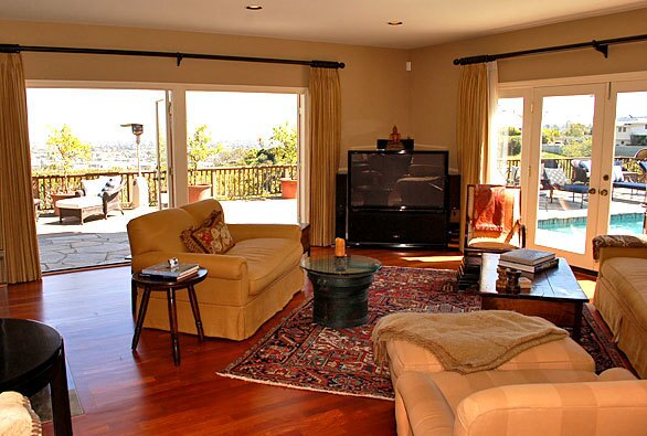 Built in 1999, the gated home has 180-degree canyon, mountain and city vistas.