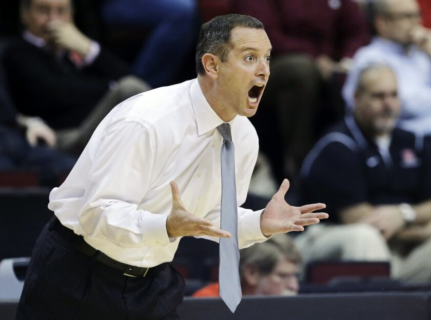 In this Jan. 17, 2013 file photo, Rutgers head coach Mike Rice reacts to play during the first half of an NCAA college basketball game against South Florida in Piscataway, N.J. Rutgers has fired Rice after a videotape aired showing him shoving, grabbing and throwing balls at players in practice and
