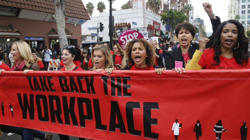 Participants including state Sen. Connie Leyva (D-Chino), second from right, march in Hollywood against sexual assault and harassment in November 2017. Lawmakers took up several bills to crack down on sexual harassment before they adjourned for the year on Aug. 31.