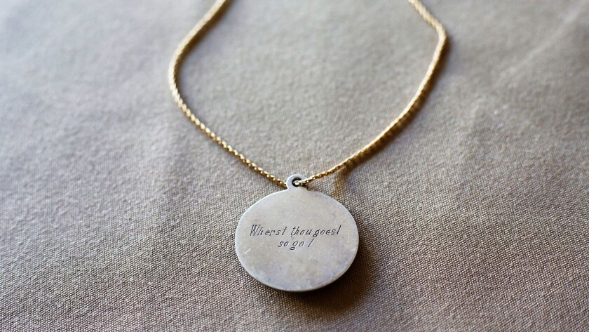 Mary Crosby, the widow of Lt. Cmdr. Frederick Crosby, wore a pendant with the inscription 'Wherst th