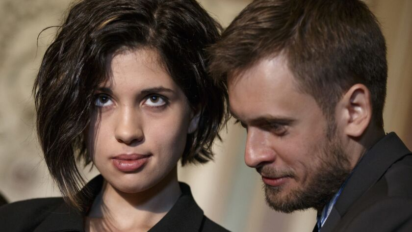 Russian political activist Nadya Tolokonnikova and husband Pyotr Verzilov, both members of the punk band Pussy Riot, are photographed in Washington on May 6, 2014.
