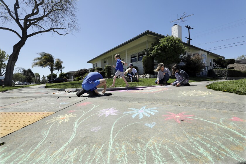 Adam Trafas and Lisa Hildreth are juggling working from home and home-schooling their four children. One thing they do, along with their neighbors, is let their kids Logan Trafas, left; Eli Trafas; Libby Trafas, and Dylan Rose Trafas, far right, do chalk drawings on the sidewalk, following a different theme every week.