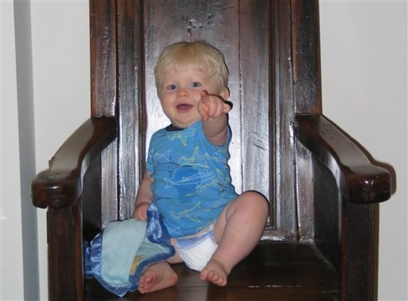 This undated handout photo provided by the journal Science shows gesturing child. Don't just talk to you toddler, gestures, too. Pointing\, waving bye-bye and other natural gestures seem to boost a budding vocabulary. (AP Photo/Science, Meredith Rowe)
