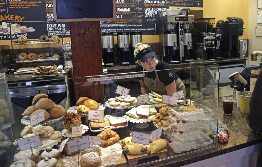 In this Wednesday, March 23, 2016, photo, Kayla Mitchell serves a customer at Good Day Cafe in North Andover, Mass. On Thursday, June 2, 2016, payroll processor ADP reports how many jobs private employers added in May. (AP Photo/Elise Amendola)