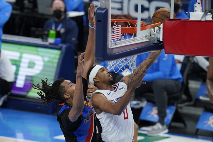 Clippers guard Jay Scrubb drives to the basket against Thunder center Moses Brown.
