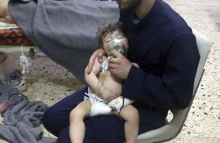 Dozens reported killed in suspected chemical attack on rebel bastion in Syria