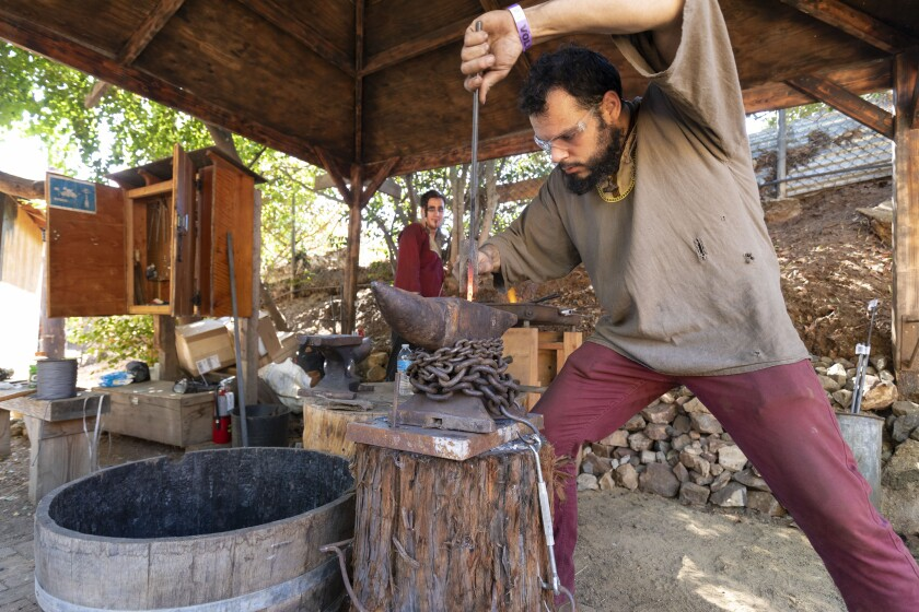 Sam Rutherford (right) and Ryan Young show off their blacksmithing skills at last year's Viking Festival in Vista.