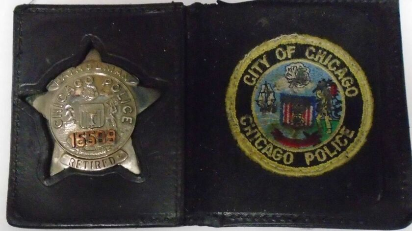 Pastini had this Chicago police badge in his plane. Orange County SheriffÕs Department